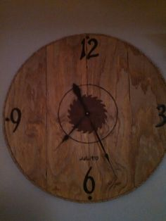 Made my own farmhouse clock. Plywood..stain..woodburning and a technique to rust the saw blade. Added rope trim. And house numbers..