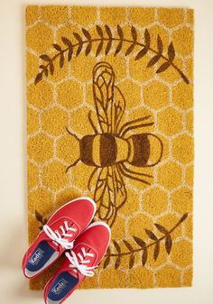 Returning to your abode is always a pleasant experience, especially with this tan doormat awaiting your arrival! The honey bee and honeycomb design of this...
