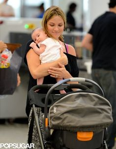 Danneel Harris Jet-Sets With Baby Justice Jay Ackles: Danneel Harris smiled while holding her new baby daughter.