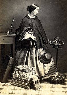 Microscope, hats, enormous books, luggage? Methinks she was photographed with more than a few of her favorite things...