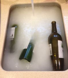remove labels from wine bottles using hot water, dish soap, baking soda, and vinegar