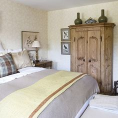 A Subdued Palette Lends A Gentle Warmth To This Country House Bedroom.