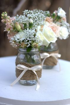 mason jar and flowers. Just use navy blue ribbon instead of the twine. Love the flower set up