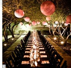 Love this place!    Guests dined at rows of long tables under a canopy of trees strung with 300 pink paper lanterns.  A Modern Museum Wedding in Las Vegas, NV