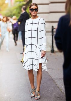 Olivia Palermo in a white and black grid print long sleeve dress and printed heels