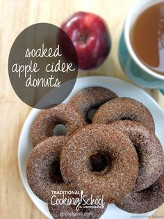 """Apple cider is almost as iconic as colored leaves. It shouts cheerfully """"Fall is here! Fall is here!"""" As families flock to pick apples, orchards  offer the ever-popular treat: apple cider flavored donuts. The common recipe is easy to spruce up and make real food friendly at home. And of course, it's best enjoyed with a warm beverage for dunking!   TraditionalCookingSchool.com"""