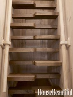 Beautifully crafted stairs of interlocking walnut treads lead to the widow's walk.