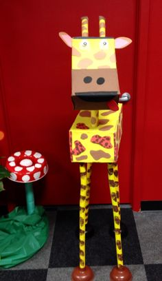 Giraffe I made from cardboard boxes, foam sheets, and construction paper. I used the plastic sound makers you get at the Dollar Store for it's legs. It's being held up by plungers! And there you have it! Using him for our Journey off the Map VBS.