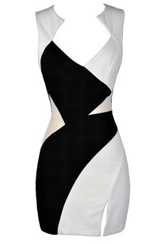 It's true what they say--opposites do attract!  The Opposite Sides Black and Ivory Colorblock Dress is made of a substantial fabric with a bit of stretch to it.  It has a unique neckline we love and wide shoulder straps.  Alternating blocks of black and ivory fabric pieced together form the bodice of this graphic fashion-forward look.  Semi-sheer mesh panels at each side allow a little bit of skin to show through.  A slit on the side of the skirt, an open back design, and a hidden back…