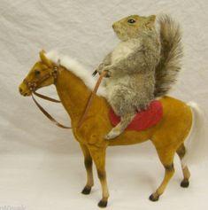 Stuffed squirrel riding a miniature horse