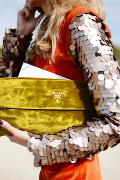 something about the clutch - the color and texture. i can do without the fish scale arms.    (via (1) Glitter Guide / Pinterest)