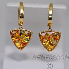 Made in USA.  Matching citrine Gem-Intrusion earrings hang on 14KT yellow gold lever-backs, and have the same star shape cutouts along the sides. Total length of earrings is 32mm, width is 14.2mm, and depth 9.6mm. Matched citrines each measure 12.2 x 12.2 x 12.2mm. Lapis, pendant, and earrings set Price: $4,800 Gemfix, San Diego, California