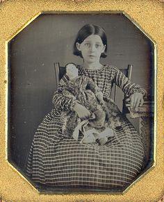 1/6 plate daguerreotype of little girl and her dolly. Looks like she really loves her.