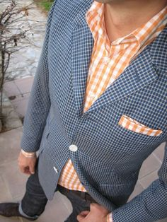 A blue gingham blazer and charcoal jeans will convey a carefree easy vibe. Turn your sartorial beast mode on and make dark brown leather brogues your footwear choice.   Shop this look on Lookastic: https://lookastic.com/men/looks/blazer-long-sleeve-shirt-jeans/17948   — Orange Gingham Long Sleeve Shirt  — Orange Gingham Pocket Square  — Dark Brown Leather Belt  — Charcoal Jeans  — Dark Brown Leather Brogues  — Blue Gingham Blazer