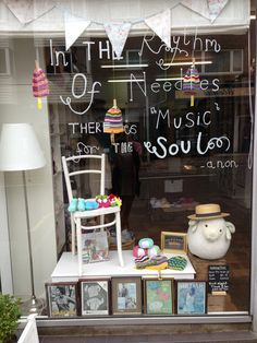 Craft & Yarn Shop display - The Knit Club Jun '13. i like the writing in the window