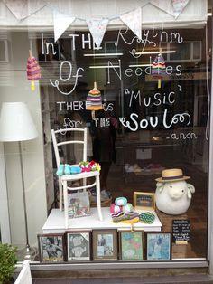 Craft & Yarn Shop display - The Knit Club Jun '13. i like the writing in the window