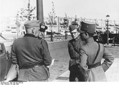 The capitulation is discussed by German and Dutch officers.