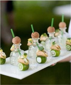 Mini tequila shots and tacos. DIY Alert - Purchase mini tequila bottles at your local liquor store, make a diagonal hole in the cork to place the straws, and voila! - Continued!