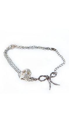 Skull & Bow Bracelet - BoyNYC, I could go w/o the bow...but still really cute!