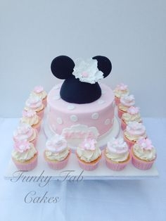 Mini mouse themed cake and cupcakes with sugar flowers @funkyfabcakes