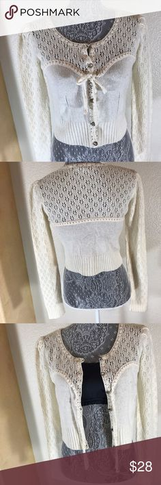 "Anthro ""Knitted & Knotted"" Knit Sweater Top! Sz S Anthro ""Knitted & Knotted"" Knit Sweater Top! •EUC •Crop style sweater •Beautiful jeweled buttons •Ties in front •Can be worn open or closed •Great for a spring/summer cover up over your favorite maxi dress! Anthropologie Tops"