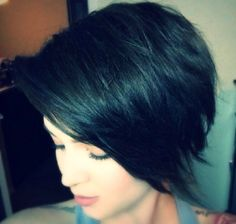 The perfect cut/long bangs for when you're in between a pixie a bob!