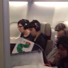 Dan and Phil on a plane wait why is Dan reading the very hungry caterpillar?!