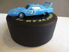 Richard Petty Goodyear Tire Display & 1:64 Diecast Car Plymouth 43 Mopar 1991