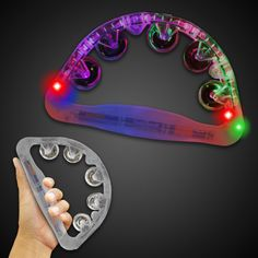"""Our 9"""" light up tambourine features 5 high powered multicolored LEDs that create an awesome lightshow when shaken. This instrument is music to your ears and lights to your eyes! Five colors of neon cymbals are included. The light up tambourine is a phenomenal promotional product for Greek festivals, tradeshows, concerts and more. Let your customers create their own jingle! Batteries are included and installed. Choking hazard, not for children under 3."""