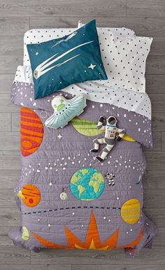 Shop Cosmos Bedding.  Get ready to explore deep space with this galaxy bedding set.  The grey quilt features printed and embroidered space-themed elements, while the coordinating sham rounds out the look.