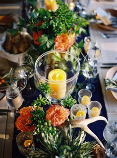Bright florals and warm colors in this tablescape! I love the mixture of candle sizes! The citrus colors make it all feel super bright!