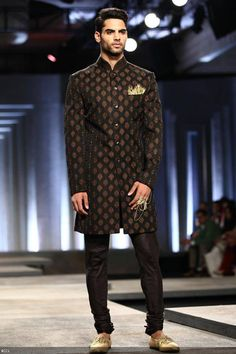 A model walks the ramp for designers Shantanu and Nikhil on Day 1 of India Bridal Fashion Week, held in New Delhi, on July 23, 2013.