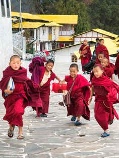 Young red-robed monks running as they get out of class from Tawang Monastery, the second largest Buddhist monastery in the world. The monastery is located in the Buddhist town of Tawang in the far northwest of Arunachal Pradesh state, India.