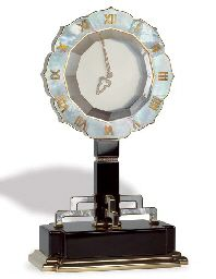 A MOTHER-OF-PEARL, ONYX AND DIAMOND MYSTERY CLOCK, BY CARTIER