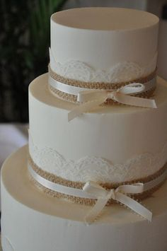 Country Wedding Cakes lace and burlap wedding cake - with ribbon would be more elegant and lovely Country Wedding Cakes, Floral Wedding Cakes, Wedding Cake Rustic, White Wedding Cakes, Rustic Cake, Cool Wedding Cakes, Elegant Wedding Cakes, Wedding Cake Designs, Wedding Cake Toppers