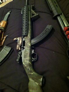 My ruger 10-22 with sightmark reflex sight, bx25 magazine , utg commando rail, and magpul afg.