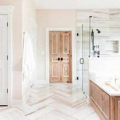 White Bathroom cabinets with marble Countertops - Contemporary - bathroom - MA Allen Interiors Taupe Bathroom, White Bathroom Cabinets, Double Door Design, Grey Interior Design, Glass Door Knobs, Foyer Design, Atlanta Homes, Transitional Bathroom, Marble Tiles