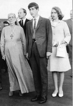 Prince Charles with his sister Anne and his paternal grandmother.