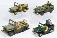 Lot 508: Japanese Lithographed Tin Military Jeep Assortment; Four items including a battery operated search light jeep and three friction driven jeeps