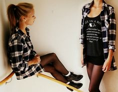Black shorts, black sheer tights, socks, ankle boots, black screen printed tee, plaid flannel shirt.