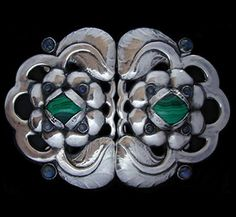 This is not contemporary - image from a gallery of vintage and/or antique objects. EVALD NIELSEN (1879-1958)  A large silver buckle of leaves and blossoms set malachite and labradorite.