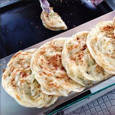 """Must try the flaky crispy ""hand grabbed spring onion pancake"" hot off the street cart. photo only."