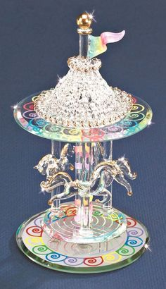 This gorgeous glass figurine features a carousel! A trio of whimsical horses with golden manes, tales and hooves whirl around a center pillar. Swarovski Crystal Figurines, Swarovski Crystals, Glass Baron, Glass Art Pictures, Color Swirl, Blown Glass Art, How To Make Paint, Crystal Decor, Glass Figurines
