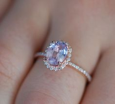 Mauve Sapphire Ring Rose Gold Engagement Ring 1.4ct oval 14k rose gold diamond ring. Engagement rings by Eidelprecious. by EidelPrecious on Etsy https://www.etsy.com/listing/274922838/mauve-sapphire-ring-rose-gold-engagement