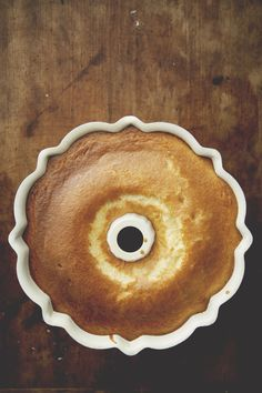 SWEETENED CONDENSED MILK CAKE    Ingredients:  For 1 Bundt Cake    2 14 oz cans sweetened condensed milk   8 Eggs, room temperature  2 cup Flour   1 teaspoon Baking powder   4 oz unsalted butter, melted  1/4 teaspoon salt    1/4 cup powdered sugar  2 teaspoons lemon zest