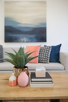 Lounge room living room styling grey sofa blue canvas pink navy blue velvet cushion coffee table styling