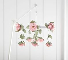 Adorning cascades of pink roses falling, this whimsical mobile will enchant your little one to sleep. DETAILS THAT MATTER • Frame is made of bamboo. • Hanging décor is made of polyester felt. • Features a sound box, which plays &