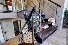 Escaliers d'intérieur en bois, fer et verre conçus par nos experts.