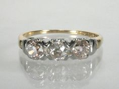 Antique Old European Cut Three Stone Diamond Engagement Ring. $785.00, via Etsy.