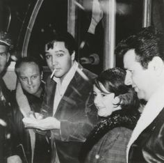 Elvis signing autographs for fans in Nashville ~ February 25-26, 1965 while he was in town for the recording session for Harum Scarum (Harem Holiday).
